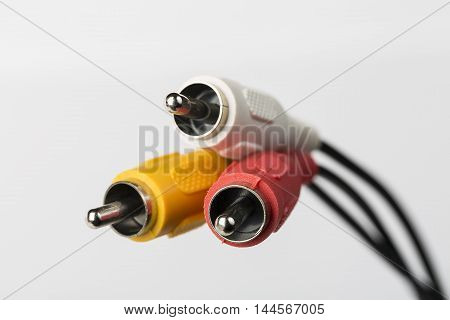 Several cables with RCA connectors for audio and video on white background.
