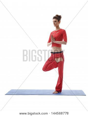 Image of yoga instructor posing while standing on one leg