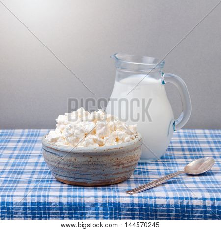 Cottage cheese and milk on tablecloth. Jewish holiday Shavuot concept