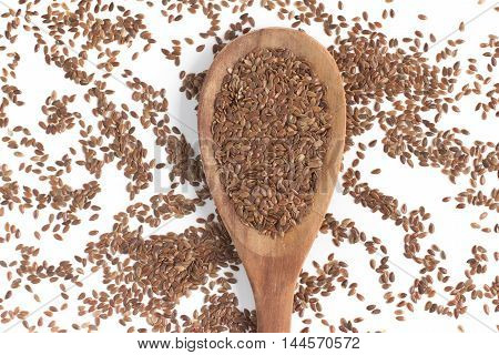 linseed into a spoon in white background