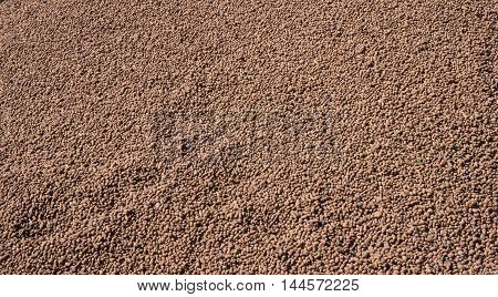 Expanded clay aggregate. Used in construction for insulation and soundproofing