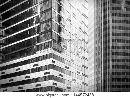 Fragment view of modern business glass buildings with monochrome effect