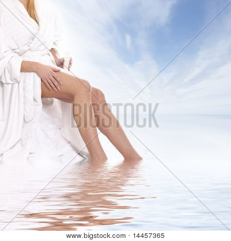 Sexy legs of young beautiful woman over natural background