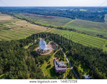 Aerial view radio telescope in forest at countryside in saint-Petersburg Russia