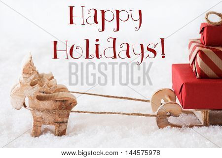 Moose Is Drawing A Sled With Red Gifts Or Presents In Snow. Christmas Card For Seasons Greetings. English Text Happy Holidays
