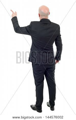young businessman full body, pointing, in a white background