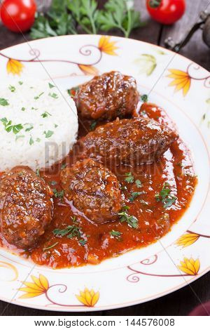 Kofta meatballs with tomato sauce and cooked rice