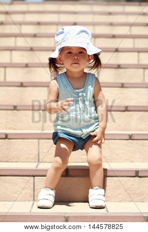 Japanese girl standing on the stairs (1 year old)