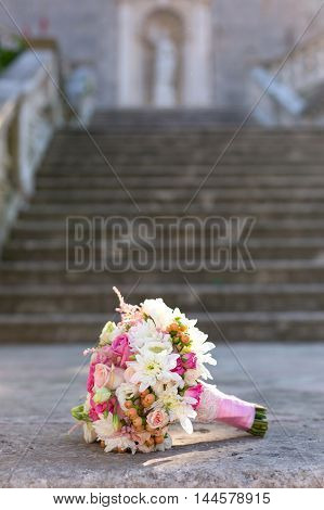 beautiful bridal bouquet on a stone background