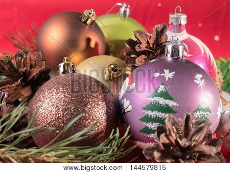 Spruce branches and Christmas balls. Festive background