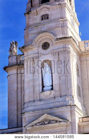 Bell Tower Angels Mary Statue Basilica of Lady of Rosary Fatima Portugal. Church created on site where three Portuguese Shepherd children saw Virgin Mary of the Rosary. Basilica created in 1953.