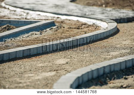 Brick Path Paving Work. Construction Site. Brick Paving Business.