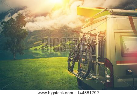 Camper Trip Adventures. Modern Camper Van Motorcoach with Bike and Kayak.