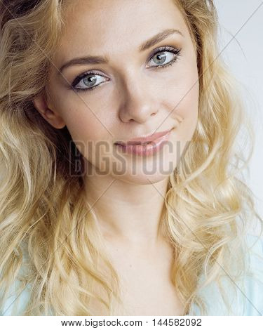 young pretty blond woman smiling on white background close up makeup, lifestyle people concept