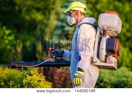 Garden Pest Control Services. Men with Gasoline Pest Control Spraying Equipment. Professional Gardening