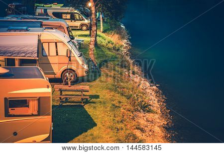 RV Park and Camping at Night. Glacial Lake Shore Camper Camping.