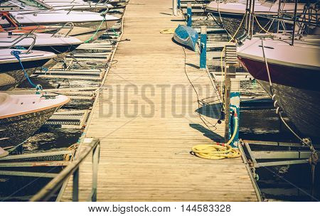 Small Motorboats Marina with Straignht Wooden Deck Alley. Boating and Fishing Theme.