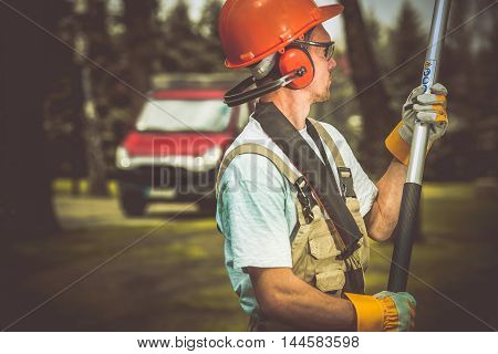 Caucasian Worker in Safety Equipment. Helmet Ear Protectors and Safety Glasses. Protective Equipment