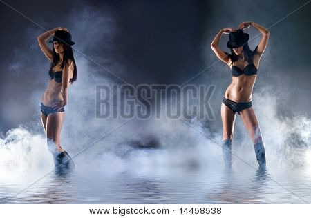 Fashion shoot of young and sexy woman in erotic lingerie over dark background