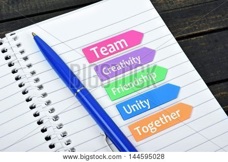 Teamwork values text on sticky colorful arrows