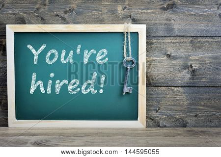You're hired text on school board and old key