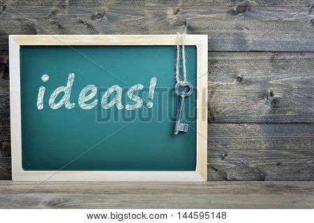Ideas text on school board and old key