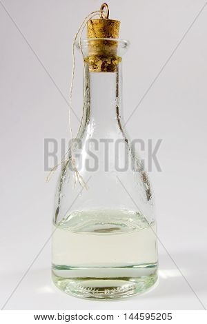 Bottle with olive oil. Bottle stopper is closed.