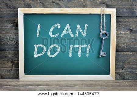 I can do it  text on school board and old key
