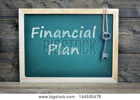 Financial plan text on school board and old key