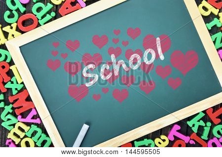 Love School text on school board and magnetic letters
