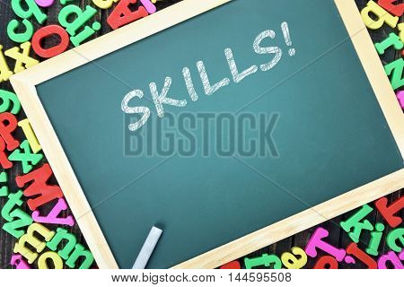 Skills text on school board and magnetic letters