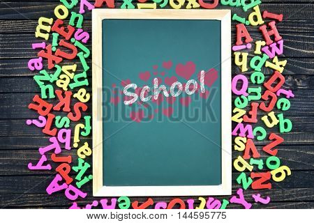 text on school board and magnetic letters