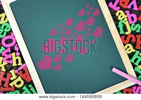Many heart shape on school board and magnetic letters
