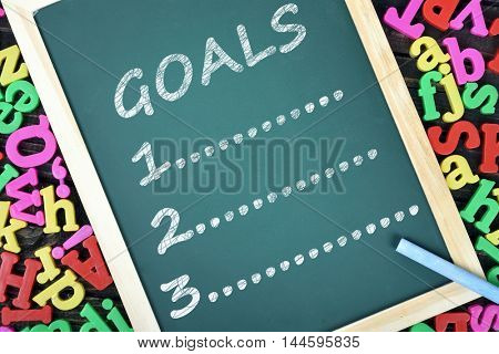 Goals list on school board and magnetic letters