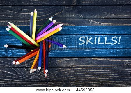 Skills text painted and group of pencils on wooden table