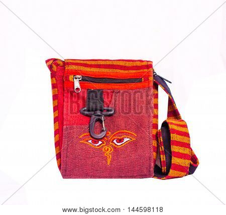 Bright red fabric women's small bag for hipster or hippie isolated on white background. Ethnic subcultural decorative accessory.