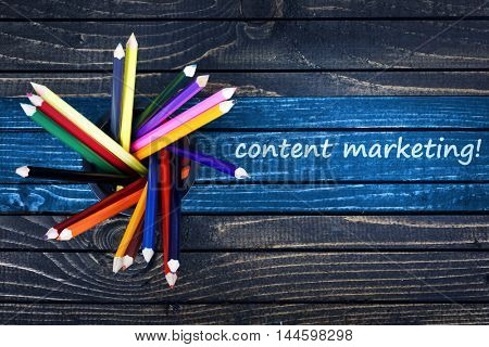 Content Marketing text painted and group of pencils on wooden table