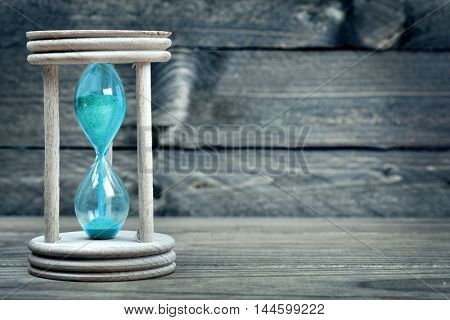 Close-up of hourglass on wooden table