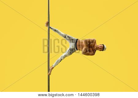 Acrobat performs complicated trick and his face is relaxed