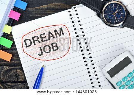 Dream Job text on notepad and watch on desk