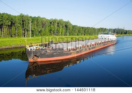 River cargo ship goes from Moscow Canal in summer