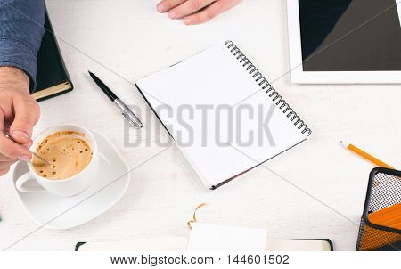 Notebook with blank pages on white home desktop. Man working in the home office