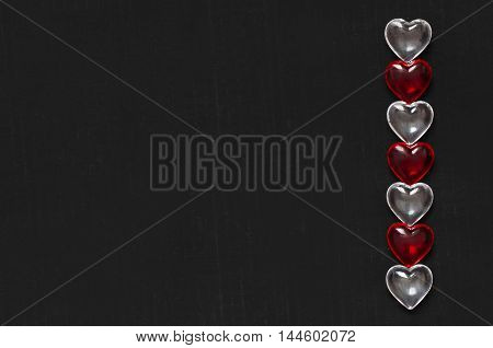 Valentines hearts made of glass on black background
