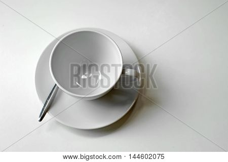White Empty Coffee Cup And Spoon