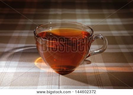 cream cheese schnitt layer cake with tea and red fresh sweet grapes on wood background