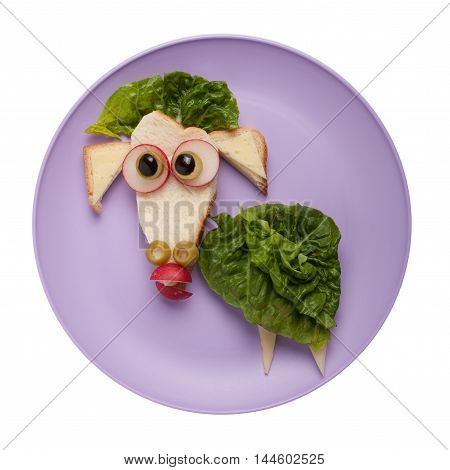 Confused sheep made of vegetables and bread on plate
