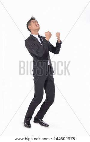 Full Portrait of a successful young businessman with his hands raised