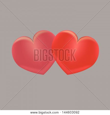 Two decorative red hearts on wooden table on grey background
