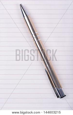 Luxury ball pen on blank notebook sheet