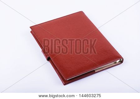 Leather luxury red diary on white background